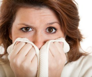 Woman scared mouth covered